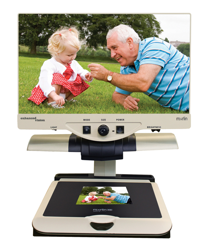 Merlin Ultra HD magnifying an image of a grandfather and his granddaughter smiling in playing in the grass on the screen.