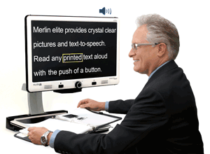 man using Merlin elite hd desktop magnifier to read