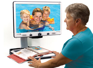 woman viewing photos on the Merlin elite hd desktop magnifier